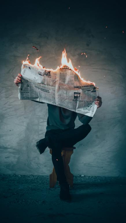 Flaming Newspaper - Photo by Elijah O'Donnell on Unsplash