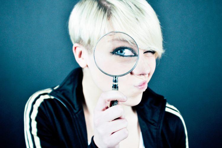 Magnifying Glass lady - Photo by Emiliano Vittoriosi on Unsplash